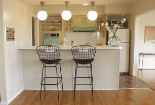 Eclectic Kitchen with full backsplash, Galley, Freestanding Full Size Top Freezer Refrigerator, Large Ceramic Tile, Wall Hood