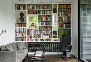 Contemporary Living Room with Casement, flush light, sliding glass door, Standard height, Hardwood floors, Built-in bookshelf