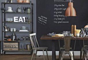 Contemporary Dining Room with Built-in bookshelf, Hardwood floors, Pendant light