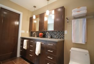 Contemporary Master Bathroom with Undermount sink, Standard height, Simple granite counters, can lights, stone tile floors