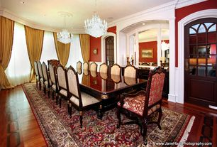 Traditional Dining Room with Built-in bookshelf, Crown molding, Hardwood floors, Standard height, specialty window