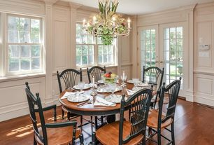 Traditional Dining Room with Chandelier, Standard height, French doors, Hardwood floors, Wainscotting, double-hung window