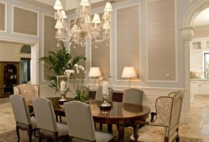 Traditional Dining Room with High ceiling, Chandelier, Restoration Hardware Saxon Table Lamp, limestone floors, Wainscotting
