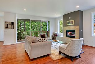Contemporary Living Room with Hardwood floors, stone fireplace, Window seat