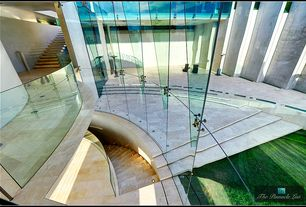 Contemporary Staircase with specialty window, can lights, High ceiling, stone tile floors, curved staircase, picture window