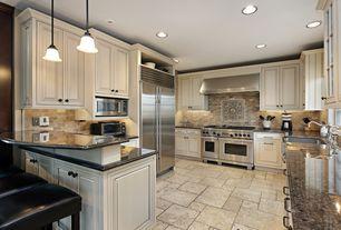 Traditional Kitchen with Glass panel, limestone tile floors, stone tile floors, double oven range, Stone Tile, U-shaped