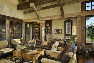 Rustic Great Room with Hardwood floors, Thomasville Ella Sofa, Cathedral ceiling, Arched window, flush light, Exposed beam
