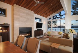Contemporary Great Room with Hardwood floors, Cathedral ceiling, stone fireplace, Ceiling fan, flush light, Wall sconce