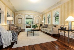 Traditional Living Room with High ceiling, French doors, Wainscotting, Casement, Crown molding, Hardwood floors, Chair rail