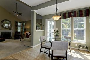 Contemporary Dining Room with French doors, Pendant light, Columns, Hardwood floors