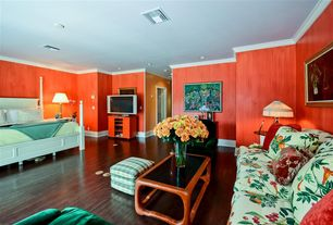 Tropical Guest Bedroom with Crown molding, Hardwood floors, Standard height, can lights, interior wallpaper