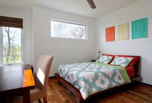 Modern Guest Bedroom with can lights, Hardwood floors, Parson chair, Ceiling fan, Wall art, Ikea malm bed frame, high