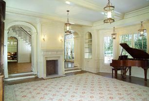 Traditional Living Room with Crown molding, Pendant light, Laminate floors, Wall sconce, Glass panel door, Fireplace