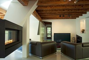 Contemporary Living Room with metal fireplace, Exposed beam, Columns, limestone floors, can lights, High ceiling, Fireplace