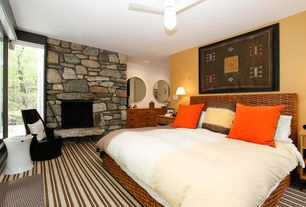 Contemporary Master Bedroom with stone fireplace, Ceiling fan, Carpet