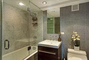 Contemporary Full Bathroom with Flush, Corian counters, Bathtub, can lights, Shower, shower bath combo, tiled wall showerbath