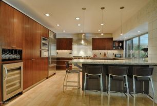 Contemporary Kitchen with Breakfast bar, Complex granite counters, European Cabinets, double wall oven, double oven range
