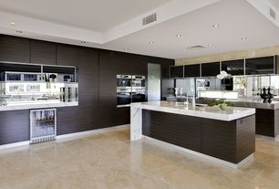 Contemporary Kitchen with Glass panel, limestone tile floors, Kitchen island, Undermount sink, Complex marble counters, Flush