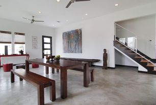 Contemporary Dining Room with High ceiling, picture window, Glass panel door, Ceiling fan, Concrete floors, can lights