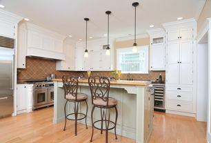 Traditional Kitchen with Kitchen island, Inset cabinets, Simple granite counters, Pendant light, Flat panel cabinets