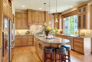 Traditional Kitchen with Kitchen island, Simple granite counters, Limestone Tile, Stone Tile, Flush, Custom hood, Glass panel
