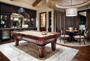 Contemporary Game Room with Exposed beam, Pendant light, Standard height, Hardwood floors