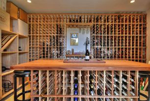 Contemporary Wine Cellar with Designer Series 180-Bottle Wine Rack Wall Unit with Table Top and Glass Rack, limestone floors