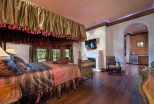 Traditional Master Bedroom with Hardwood floors, Standard height, can lights, Casement, Fireplace, Cement fireplace
