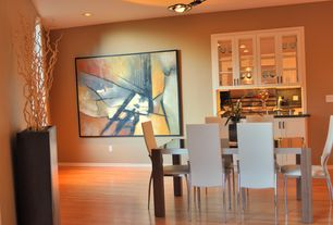 Contemporary Dining Room with Built-in bookshelf, Hardwood floors, flush light