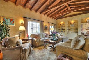Traditional Living Room with Hardwood floors, Built-in bookshelf, Exposed beam, Wall sconce, interior wallpaper, High ceiling