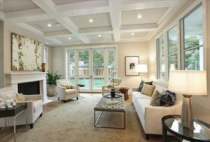 Contemporary Living Room with Laminate floors, specialty door, French doors, Exposed beam, Crown molding, Cement fireplace