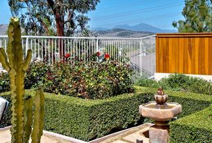 Traditional Landscape/Yard with Fountain, exterior tile floors, Fence, Raised beds, exterior concrete tile floors