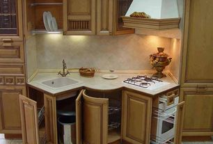 Traditional Kitchen with Standard height, Stone Tile, Custom hood, limestone tile floors, wall oven, drop-in sink, One-wall