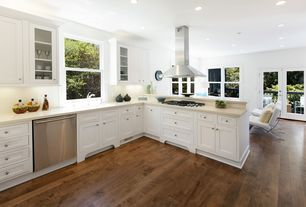 Traditional Kitchen with Barcelona chair reproduction, Stone Tile, Flat panel cabinets, Inset cabinets, Undermount sink