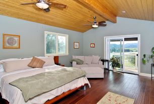 Contemporary Guest Bedroom with Ceiling fan, Hardwood floors, Exposed beam