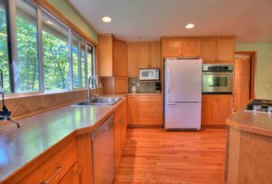 Country Kitchen with Formica counters, Hardwood floors, L-shaped, Stone Tile, European Cabinets, Limestone Tile, Flush