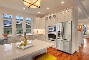 Traditional Kitchen with Alaskan white granite, Simple granite counters, Flush, L-shaped, Breakfast bar, Glass panel