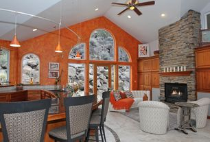 Traditional Living Room with stone tile floors, metal fireplace, specialty window, Arched window, High ceiling, French doors