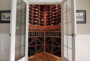 Traditional Wine Cellar with Built-in bookshelf, Standard height, Hardwood floors