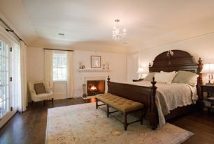 Traditional Master Bedroom with French doors, Hardwood floors, interior wallpaper, Chandelier, Cement fireplace