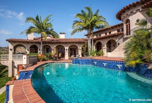 Mediterranean Swimming Pool with French doors, Outdoor kitchen, exterior brick floors, Pool with hot tub, Arched window