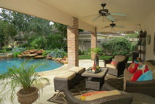 Traditional Porch with Raised beds, Tortuga portside 6 piece conversation set, exterior tile floors, Fence