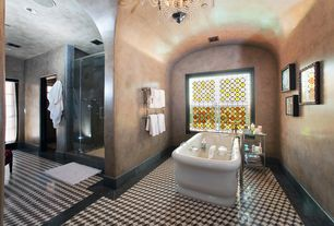 Mediterranean Master Bathroom with Chandelier, Freestanding, Stained glass window, Master bathroom, Carpet, High ceiling