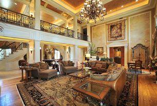 Mediterranean Living Room with Handscraped maple nutmeg solid hardwood flooring, French doors, Columns, Custom railing