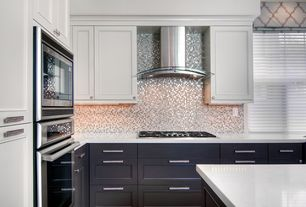 Contemporary Kitchen with Undermount sink, Corian- Designer White, Simple marble counters, Framed Partial Panel, L-shaped