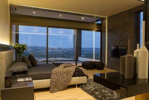 Contemporary Master Bedroom with Built-in bookshelf, specialty window, Standard height, sliding glass door, can lights