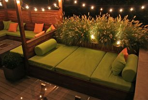 Contemporary Deck with Exterior accent lighting, Raised beds, Fence, Built-in outdoor bed, Fire pit, Pathway