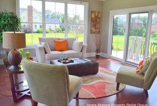 Modern Living Room with Wildon Home Cumberland Grove Loveseat, Handscraped wood floors, Crown molding, High ceiling