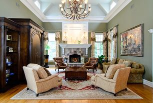Traditional Living Room with Wall sconce, Hardwood floors, Crown molding, Chandelier, Exposed beam, Skylight, stone fireplace
