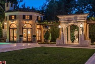 Mediterranean Landscape/Yard with Transom window, French doors, Raised beds, picture window, Trellis